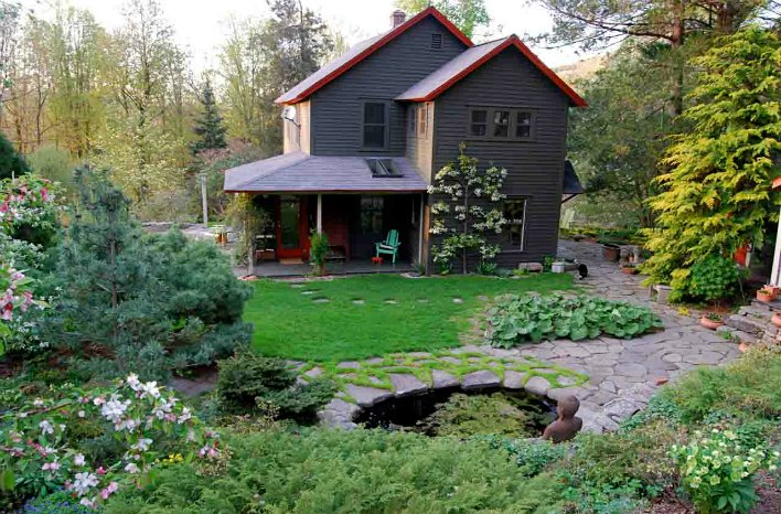 Margaret Roach's deep olive paint color to ground the house to the landscape
