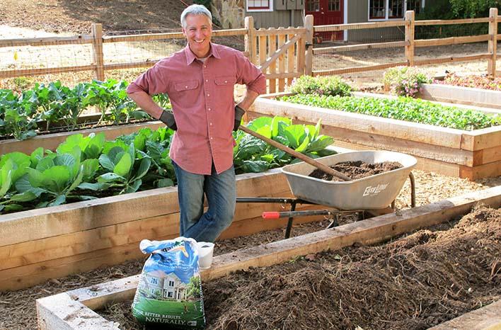 Joe Lamp'l amending raised bed soil at the GardenFarm