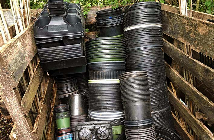 Stacks of plastic garden pots