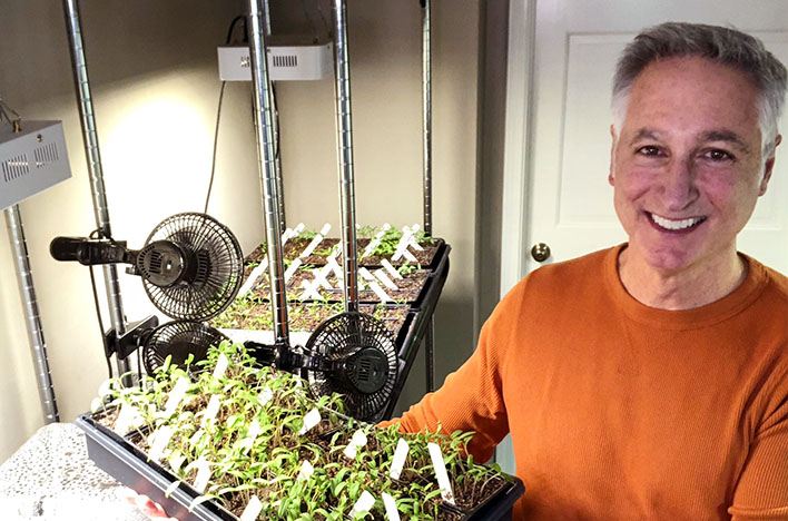 Joe Lamp'l with a new batch of tomato seedlings