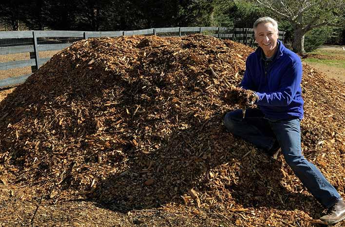 Joe Lamp'l with arborist wood chips