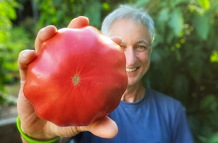 Joe Lamp'l holding tomato
