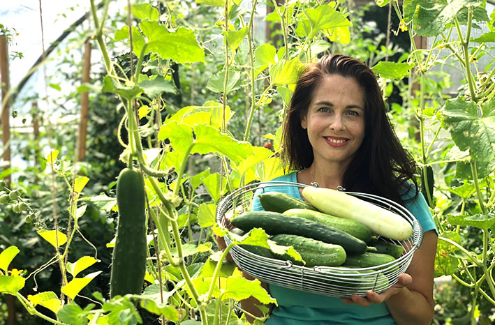 Season extension expert Niki Jabbour holding basket of veggies