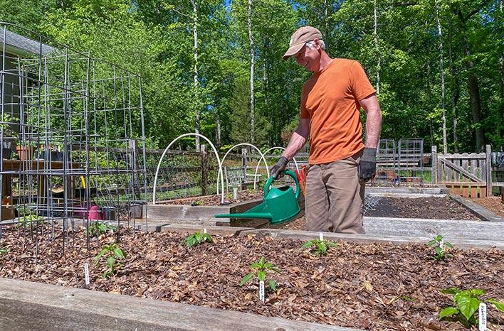 Joe Lamp'l watering plants