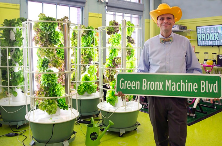 Stephen Ritz holding Green Bonx Machine Blvd sign