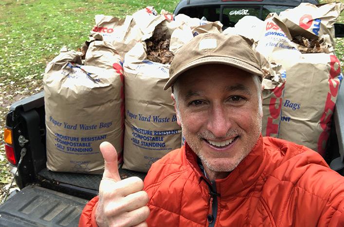 Joe with bags of leaves