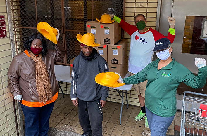 Stephen Ritz and others with cheese hats