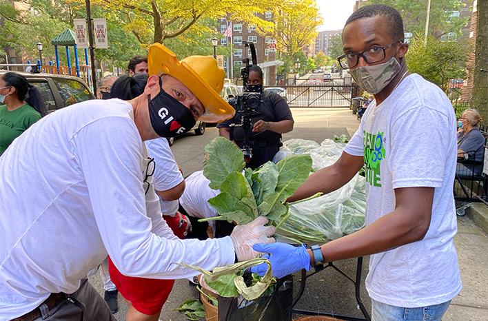Stephen Ritz bagging vegetables