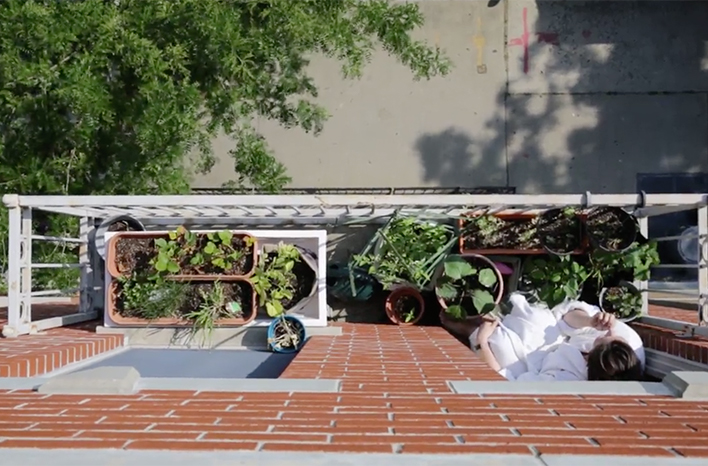 Maria Failla on her balcony with here 2020 gardening project.