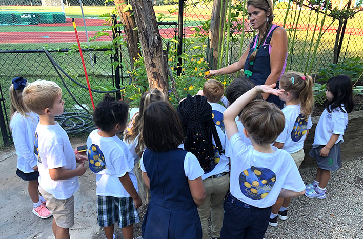Kids learning at the Bright School garden