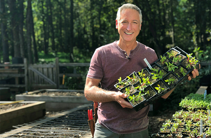 Joe Lamp'l holding seedling tray