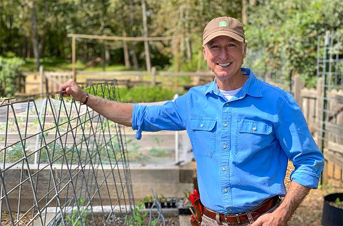 Joe Lamp'l with a livestock teepee trellis