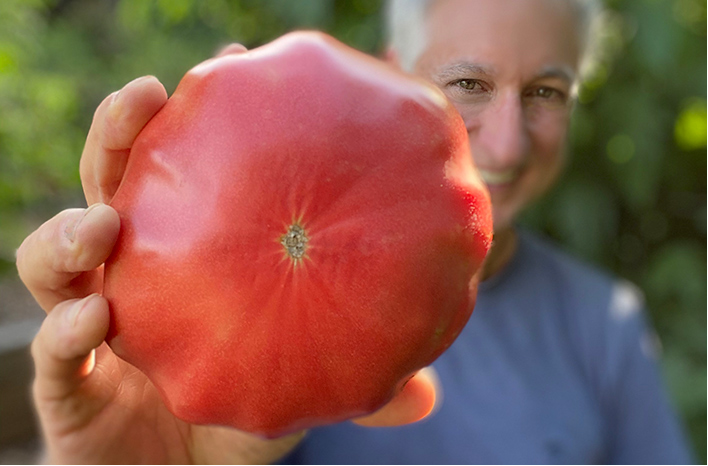 Joe Lamp'l with a large tomato