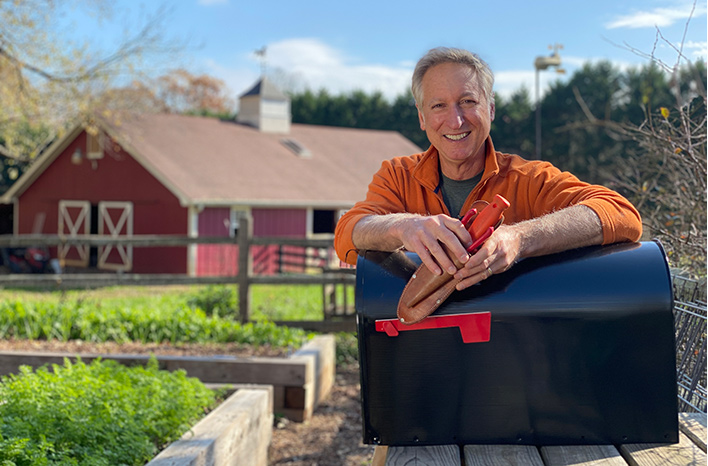 Joe Lamp'l with his garden mailbox where tools are stored.
