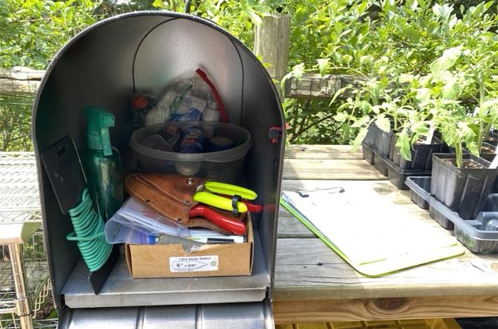 Tools in an organized garden mailbox