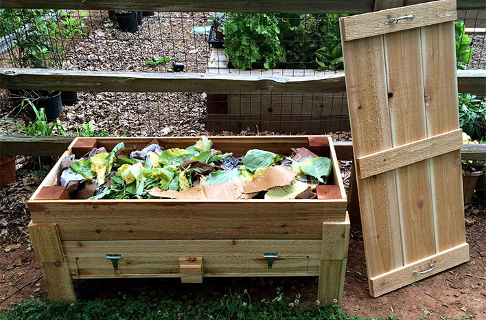 A worm bin full of vegetable scraps for the worms to eat.