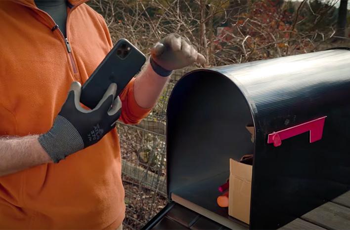 Storing a phone in a garden mailbox