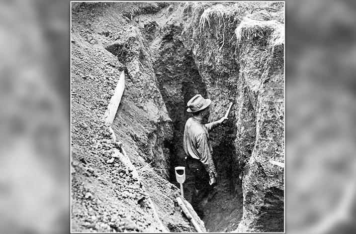 John Weaver in a trench