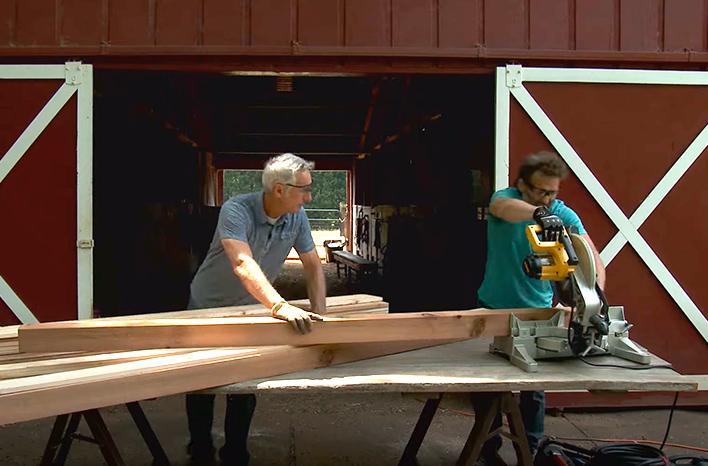 Joe Lamp'l and Todd Brock cut lumber to make a worm bin.