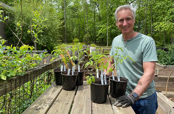Joe with tomato seedlings