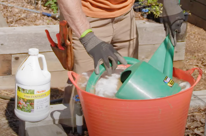 I make one large batch of liquid fertilizer, then dip my watering can into the tub to fill it up quickly. I can refill the can this way multiple times.